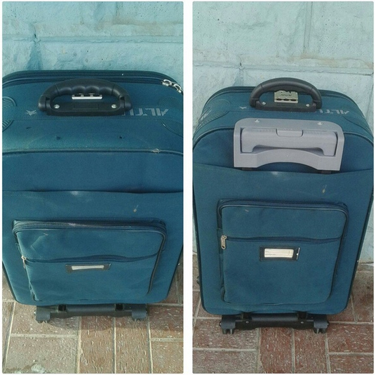 установка новой выдвижной ручки чемодана